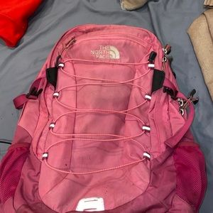 North face pink book bag